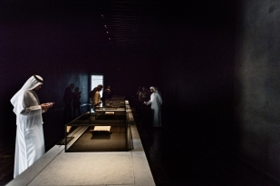 ABU DHABI, UNITED ARAB EMIRATES-November 13, 2017: Visitors to he Louvre view the Pentateuch: First part of the Torah. Yemen, Sana'a 1498. Ink on paper. Louvre Abu Dhabi which is exhibited alongside a seventh-century Quran and gothic Bible. Louvre Abu Dhabi CREDIT: Katarina Premfors/The New York Times