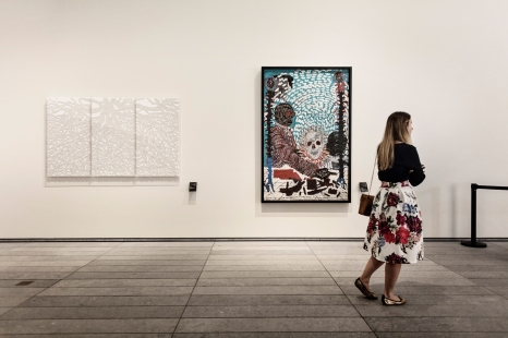 ABU DHABI, UNITED ARAB EMIRATES-November 13, 2017: A woman in the final gallery 'A Global Stage'. Louvre Abu Dhabi CREDIT: Katarina Premfors/The New York Times