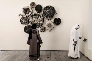 ABU DHABI, UNITED ARAB EMIRATES-November 13, 2017: Food for thought.Al Muallaqat by Maha Malluh. Saudi Arabia, Riyadh. Eleven burned cooking pots. 2013. Louvre Abu Dhabi CREDIT: Katarina Premfors/The New York Times