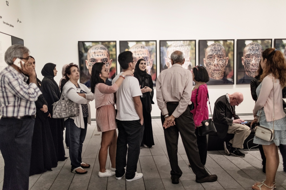 ABU DHABI, UNITED ARAB EMIRATES-November 13, 2017: Visitors in the final gallery 'A Global Stage' listen to a Louvre Guide. Louvre Abu Dhabi CREDIT: Katarina Premfors/The New York Times